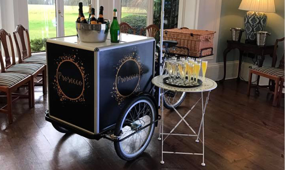 Carlicious Champagne tricycle at a corporate event