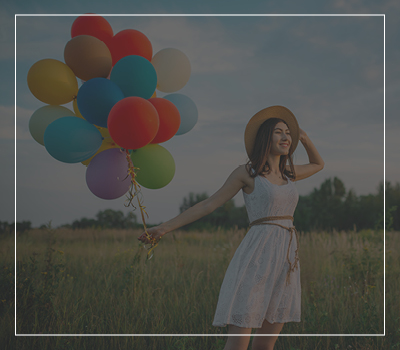 Girl celebrating with balloons
