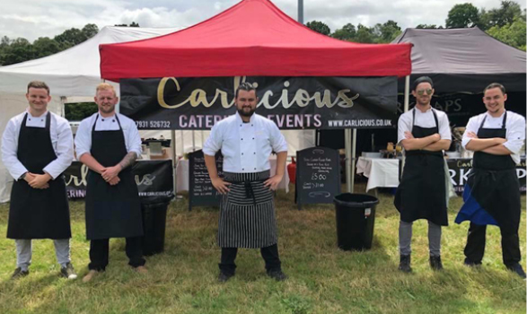 Carlicious team staffing a catering stall at an outdoor event